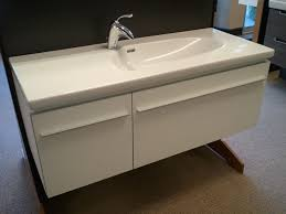 Bathroom Vanity Countertops Ideas by Appealing Corner Bathroom Vanity Using Creamy Veined Cultured