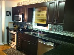 dark brown cabinets with black countertops love around the