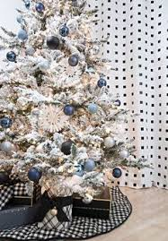 White Christmas Tree Decorated Blue And Gold Decor Is Ideal For A White Christmas Tree