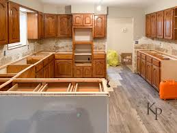 best flooring for honey oak kitchen cabinets kitchen cabinets in alabaster painted by payne