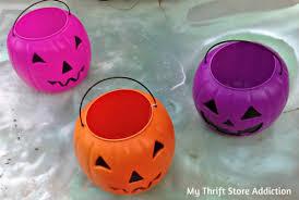 plastic pumpkins my thrift store addiction repurposed plastic pumpkin planter fall