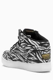 skechers energy lights black buy skechers black energy lights outglow lace up sneaker from the