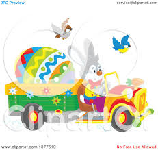 clipart of a happy easter bunny rabbit driving a truck with a