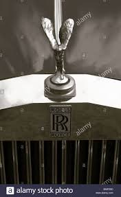 the front grill and flying ornament of the rolls royce