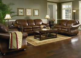 brown leather sofa set for living room with dark hardwood floors