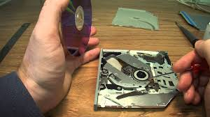 how to remove a cd rom disk that is stuck in a slot loading