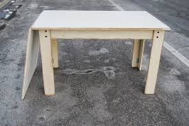 how to make a drop leaf table define your sign make a drop leaf plywood sewing table