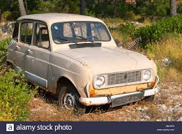 renault europe a very old renault 4 light brownish grey rusting or parked in a
