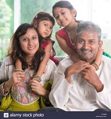 happy indian family at home asian parents piggyback their