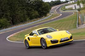 yellow porsche side view 2014 porsche 911 turbo and turbo s first drive automobile magazine
