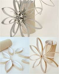 snowflake ornaments made from cardboard rolls and spray paint