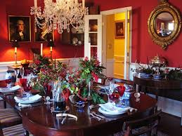 red wall color with decorative mirror for christmas eve dining