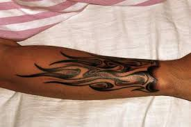 black ink fire and flame tattoo on right arm