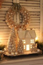 winter decor you can buy these houses at hobby lobby paint white