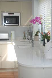 White Kitchen Cabinets With Grey Countertops by Backsplash Kitchen White Quartz Countertop Quartz The New