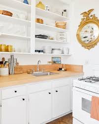 how to fix kitchen base cabinets to wall how to organize kitchen cabinets storage tips ideas for