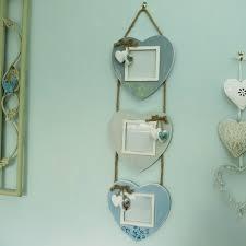 blue hanging heart ladder photo frames