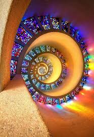 the looping stained glass window on the ceiling of the chapel of