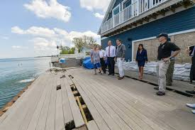 after cuomo blasts ijc for lake ontario flooding dec chief walks andrew cuomo toured homes in greece ny along lake ontario damaged by high water levels photo ny governor s office