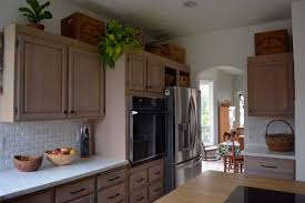 can you stain finished cabinets what we learned from a forever project to refinish kitchen