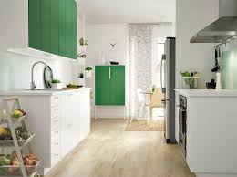 kitchen with white drawers and green doors