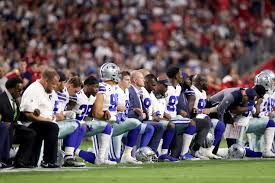 jerry jones kneels with cowboys players prior to anthem in arizona