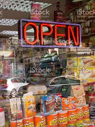 shop open sign lights shop window of convenience store with open sign neon lights stock