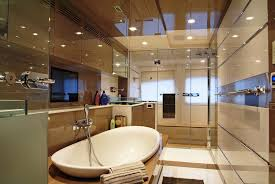 luxury master bathroom designs with stone wall and black