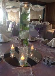 Vases With Flowers And Floating Candles Centerpiecerentals