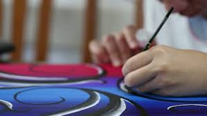 relaxing painting videos blurry young teenage girl painting on canvas closeup on table