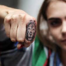 finger tattoo lioness collection of 25 lion face tattoo on finger
