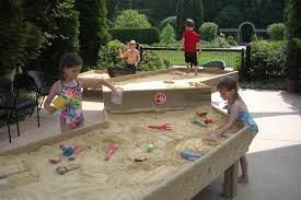 decorating summer park with sandboxes and wood box also toys and
