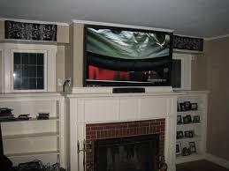 100 tvs over fireplace unisen media llc tv mounted over