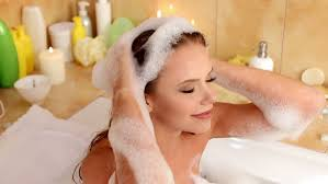 Women Bathtub Relaxed Woman Lying In Bubble Filled Bath Washing Her Hair Stock