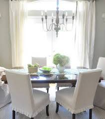 slipcovered parsons chairs and wooden dining table parsons