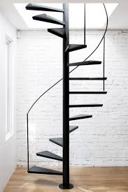 spiral staircase floor plan anne sophie goneau exposes brickwork in montreal apartment