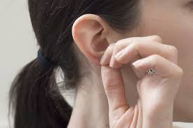 ear earing how to remove pierced earrings from your ear livestrong