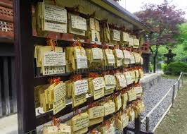 written on a wooden wish card is tradition when visiting