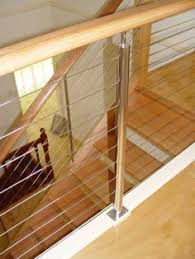 frameless glass balustrades with offset stainless steel handrail