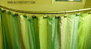 green color of curtain with gold color of l shaped rod in using