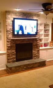 led tv above wood burning fireplace stand ct mounting wall bedroom