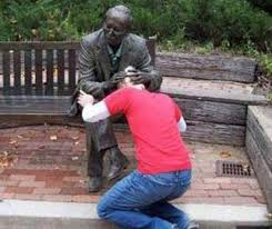 50 people having too much fun with statues