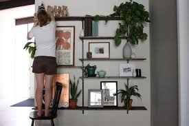 How To Arrange Indoor Plants by Enjoy It By Elise Blaha Cripe Wall Of Shelves