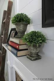 Joanna Gaines Design Book Fixer Upper Host Johanna Gaines Adds A Trademark Magnolia Wreath