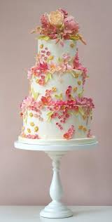 a variety of summer flowers in soft colors make this cake