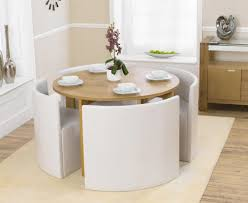 Kitchen Table Close Up Oslo 120cm Oak Stowaway Dining Table With White Chairs The Great