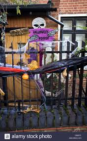 halloween decorations on fence outside of house stock photo