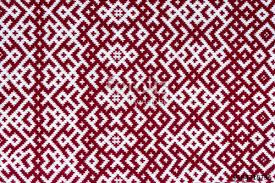 knitted texture with the pattern of national symbol of latvia