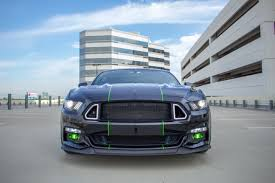 black and teal car black and lime howler americanmuscle