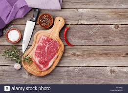 Wooden Table Top View Raw Beef Steak And Spices On Wooden Table Top View With Copy